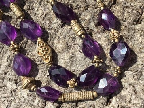 Faceted Amethyst with silver dipped in Gold Hand Engraved Beads