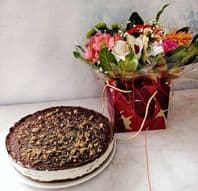 Mascarope Snickers Cheesecake and a bag of mixed fresh flowers